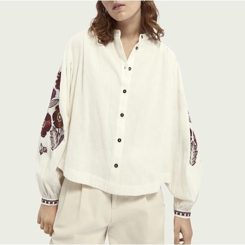 Craquez pour cette magnifique blouse ample à larges manches